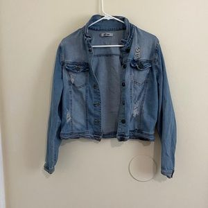SUPER cute jean jacket that is distressed